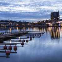 A bridge leading to the city with empty pier in front. Picture is taken in Jyv?skyl?, Finland.